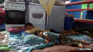 Children rest in a flood evacuation centre in Cobija, northern Bolivia