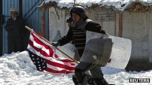 Afghan soldier runs with American flag