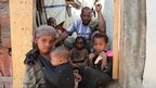 Faduma Aden Mohamud's husband and their children at their house in a displacement camp in the Somali capital, Mogadishu