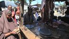 Faduma Aden Mohamud buys meat at a market stall in south-west Mogadishu, Somalia's capital