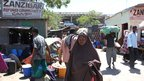Faduma Aden Mohamud walks home to her displacement camp with her shopping through the Zanzibar Refugee Community Camp, an area in south-west Mogadishu, the capital of Somalia