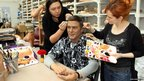 Staff at Madame Tussauds touch up the wax figure of actor George Clooney.