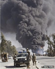 Smoke during a protest against Koran burnings in Jalalabad province