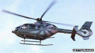 Helicopter leaves London Heliport in Battersea