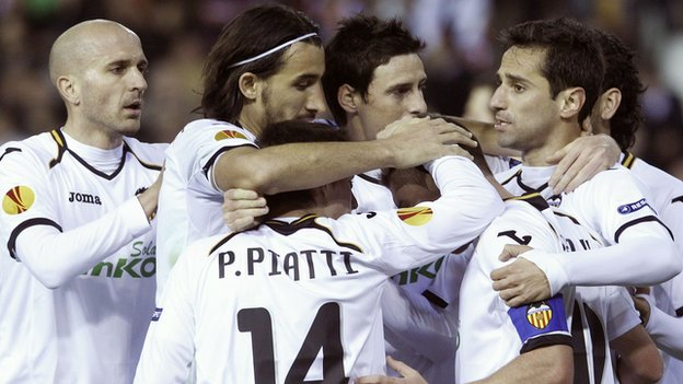 Valencia players celebrate their goal