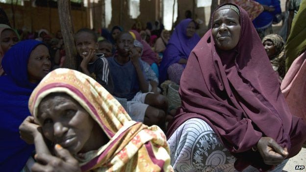 Somalis queue at a food aid distribution centre in Mogadishu