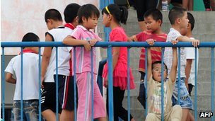 Students playing at a migrant school on the northwestern edge of Beijing, 23 August 2011