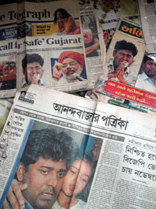 Newspapers carrying Qutubuddin Ansari's pictures