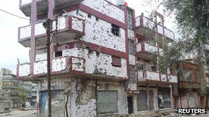 Damaged houses are seen in the Bab Sabaa neighbourhood of Homs in this picture released by opposition activists