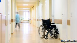 Wheel chair in a corridor