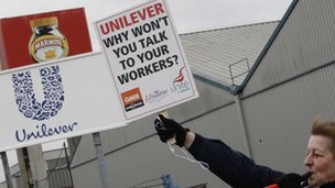 "A striking worker stands on a picket line outside Unilever's Marmite factory in Burton-Upon-Trent, central England, January 25, 2012. Workers at Unilever took part in 11 days of strike action over the consumer goods company""s decision to close its final salary pension scheme"