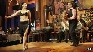 (File photo) A woman dances on stage while musicians play