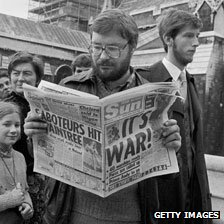 "Man reads The Sun headlined: ""It's War"""