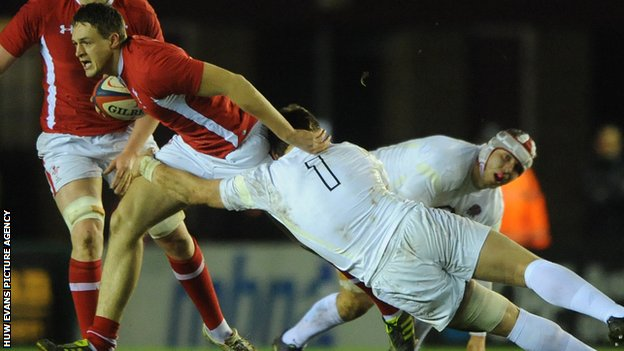 Wales' Cory Allen is tackled by England's Luke Cowan-Dickie