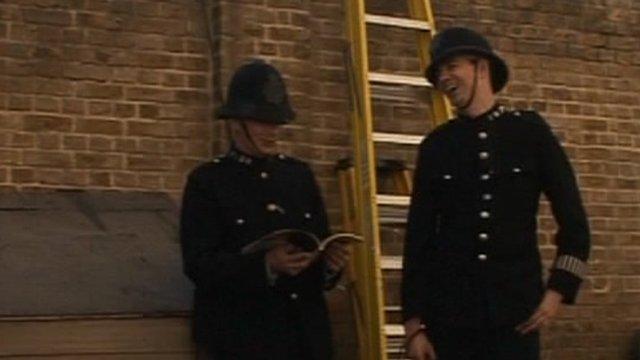Two actors in police uniform