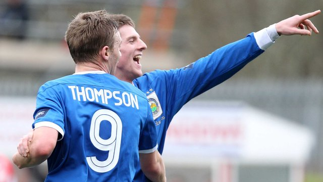 Linfield's Peter Thompson celebrates with goal scorer Daryl Fordyce