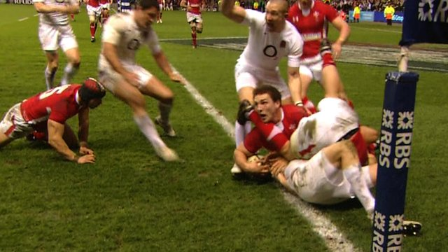 David Strettle's attempt to score a try is held up by George North