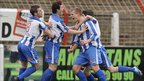 Coleraine players celebrate Aaron Boyd's opening goal in the 3-3 draw away to Glentoran