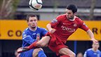 Ryan Harpur of Dungannon Swifts competes against Portadown midfielder Neil McCafferty