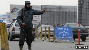 An Afghan policeman keeps watch at a check point in Kabul