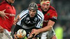 Cardiff Blues wing Tom James is tackled by Munster's Mick O'Driscoll