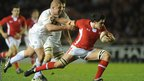 Wales' Ellis Jenkins tries to escape the clutches of England's Koree Britton  during the Under-20s Six Nations clash at The Stoop