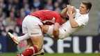 George North executes arguably the tackle of the match on England fly-half Owen Farrell