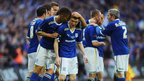 Joe Mason of Cardiff City (centre) celebrates with team-mates after he scores their first goal