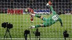 Cardiff goalkeeper Tom Heaton repeats his semi-final heroics by saving Steven Gerrard's opening penalty for Liverpool as the Carling Cup final moves to a shoot-out