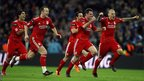 Liverpool players celebrate winning the penalty shoot-out during the Carling Cup Final at Wembley Stadium