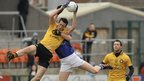 Ulster midfielder Dan Gordon beats Munster opponent Seamus Scallion to the high ball in the Interprovincial final at the Athletic Grounds in Armagh