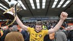 Ulster captain Darren Hughes celebrates with the Interprovincial trophy after the 3-11 to 1-15 win over Munster