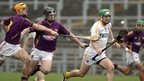 Wexford pair Eoghan Quigley and Darren Stamp give chase to Saffrons forward Shane McNaughton in the Division 1B encounter