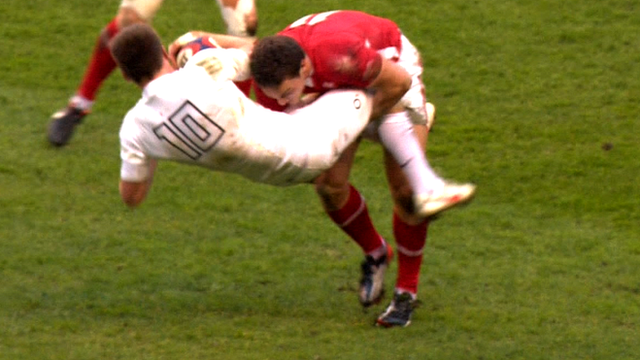 Owen Farrell is tackled by George North