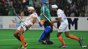Sandeep Singh (L) of India celebrates with teammate Gurwinder Singh Chandi after scoring a goal during the men's field hockey finals match between India and France of the FIH London 2012 Olympic Hockey qualifying tournament at the Major Dhyan Chand National Stadium in New Delhi on February 26, 2012