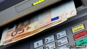 Euro notes being dispensed at an ATM