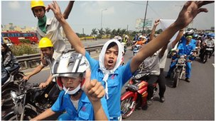 Indonesian workers occupy Jakarta's main toll road during a protest