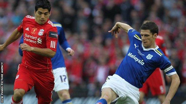 Mark Hudson (right) challenging Liverpool's Luis Suarez