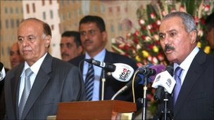 Ali Abdullah Saleh and Abdrabbuh Mansour Hadi at the handover ceremony