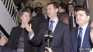 President Bashar al-Assad, with his wife Asma, after casting his vote in Syria's referendum