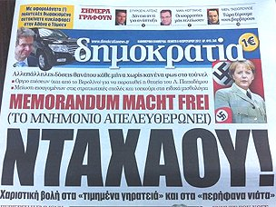 Chancellor Merkel in Nazi armband, on Greek newspaper front page