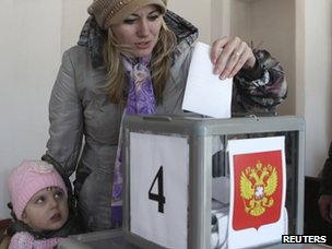 A woman casts her ballot