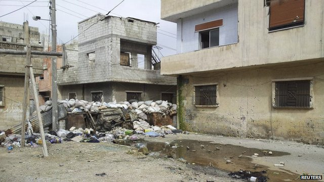 Damaged houses in Karm Al Zaytoon, a neighbourhood of Homs
