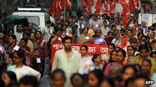 Activists of trade unions participate in a rally to show support for the All India General Strike, in Siliguri on 27 February 2012