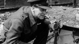BBC correspondent CD Adamnson recording a report during World War II