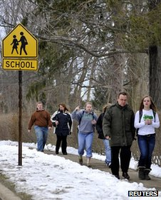 Parents walk their children home from school in Chardon, Ohio 27 February 2012