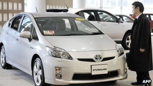 Consumer looking at Prius car in Japan