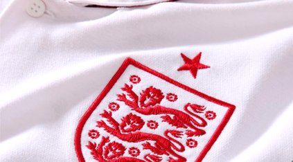 Close up of England's football kit showing three lions embroidered badge