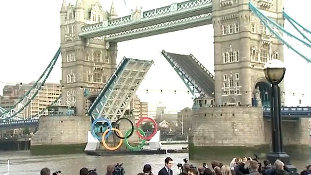 Olympic rings float down Thames