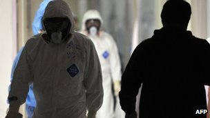 Workers at the Fukushima nuclear power plant's emergency operation centre